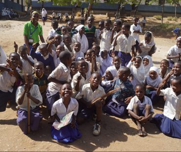 GEp Coordinator Rehema w/ Students at Mnaida Primary School